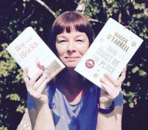 Lady holding up books