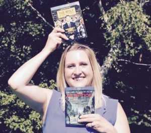 Lady holding up DVD's